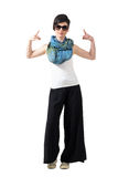Rocker girl with sunglasses showing devil horns rock and roll sign with both hands. Stock Photo