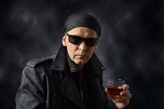 Rocker with glass of whiskey on black background. Stock Photography