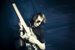 Rocker and guitar royalty free stock photos