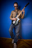 Rocker with guitar Royalty Free Stock Image