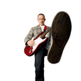 Rocker with guitar and foot Stock Image