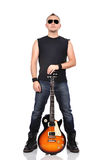 Rocker holding guitar Stock Photo
