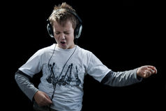 Rocker kid on black Stock Images