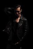Rocker posing in dark studio with hand in pocket Royalty Free Stock Photos
