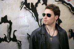 Rocker rock star young man sunglasses Royalty Free Stock Image