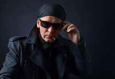 Rocker with sunglasses on black background. Royalty Free Stock Photos