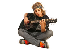 Rocker teen with acoustic guitar. Rocker teen with bandana playing acoustic guitar isolated on white background Stock Photography