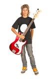 Rocker teen boy with bass guitar Royalty Free Stock Photos