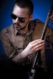 Rocker tuning guitar Royalty Free Stock Images