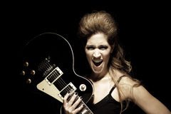 Rocker woman with guitar Royalty Free Stock Photos