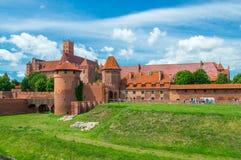 rockera befläckte sikten för borggårdEuropa den glass gotiska mest stora malbork poland Arkivfoto