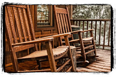 Rockers in Snow. Back porch rockers after morning snowfall North carolina Stock Images
