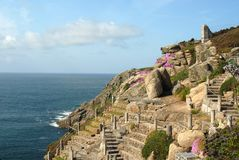 Rockery Gardens. Rockery Garden situated on a cliff side with stone staircases and red or purple flowers Stock Photography