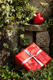 Rockery with a red heart and a present Royalty Free Stock Photos