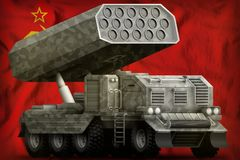 Rocket artillery, missile launcher with grey camouflage on the Soviet Union SSSR, USSR national flag background. 9 May, Victory. Rocket artillery, missile Royalty Free Stock Image