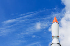 Rocket in the blue sky with clouds Royalty Free Stock Photos