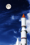 Rocket in the blue sky with clouds Royalty Free Stock Photography