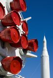 Rocket boosters. Against a bright blue sky with another rocket in the background stock image