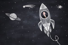 Rocket with businessman Stock Image