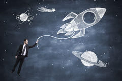 Rocket and businessman Stock Image
