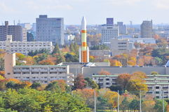 A rocket in a city during autumn season. Tsukuba Science City is gazetted as the center for research in Japan. This picture shows the  main landmark of the city Royalty Free Stock Image