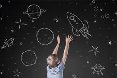 Rocket in drawn space Royalty Free Stock Images