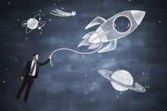 Rocket e homem de negócios Imagem de Stock