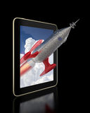 Rocket flying out of a Tablet Stock Image