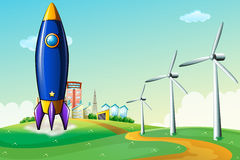A rocket at the hill near the windmills Royalty Free Stock Photo
