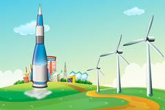 A rocket at the hilltop with windmills Stock Photos