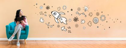Rocket illustration with woman using a tablet royalty free stock images