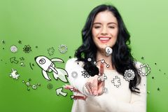Rocket Illustration with young woman. Rocket Illustration  with young woman pointing on a green background Royalty Free Stock Photography