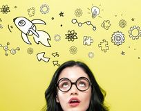 Rocket illustration with young woman. Wearing eye glasses royalty free stock photography