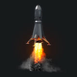 Rocket launch on dark background stock photography
