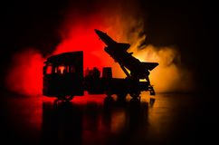 Rocket launch with fire clouds. Battle scene with rocket Missiles with Warhead Aimed at Gloomy Sky at night. Rocket vehicle on War Stock Image
