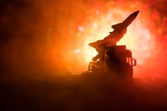 Rocket launch with fire clouds. Battle scene with rocket Missiles with Warhead Aimed at Gloomy Sky at night. Rocket vehicle on War. Backgound. Selective focus Royalty Free Stock Photos