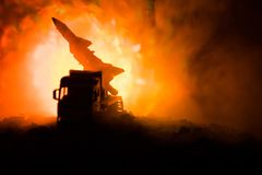 Rocket launch with fire clouds. Battle scene with rocket Missiles with Warhead Aimed at Gloomy Sky at night. Rocket vehicle on War. Backgound. Selective focus Stock Images
