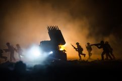 Rocket launch with fire clouds. Battle scene with rocket Missiles with Warhead Aimed at Gloomy Sky at night. Soldiers and Rockets Stock Photo