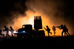 Rocket launch with fire clouds. Battle scene with rocket Missiles with Warhead Aimed at Gloomy Sky at night. Soldiers and Rockets Stock Photography