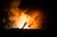 Rocket launch with fire clouds. Nuclear Missiles With Warhead Aimed at Gloomy Sky at night. Balistic Rockets War Backgound. World. Rocket launch with fire clouds Stock Image
