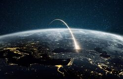 Free Rocket Launch On A Night Planet Earth With Lights. Concept Of Successful Satellite Launch. Spaceship Flies Over The Planet. Stock Photo - 183752380