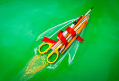 Rocket made from School supplies on Green chalkboard  Back to s. Chool background Royalty Free Stock Images
