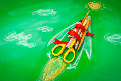 Rocket made from School supplies on Green chalkboard  Back to s. Chool background Stock Photography