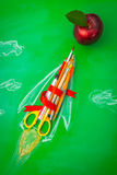 Rocket made from School supplies on Green chalkboard  Back to s. Chool background Royalty Free Stock Photo