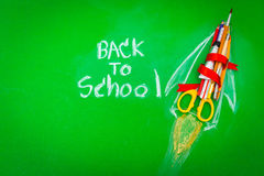 Rocket made from School supplies on Green chalkboard  Back to s. Chool background Royalty Free Stock Photos