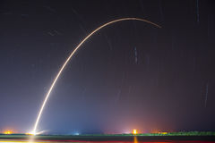 Rocket at Night Time Lapse Photo Stock Image