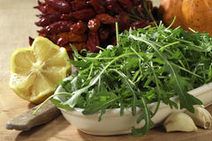 Rocket plant salad. In a tray with lemon Royalty Free Stock Photography