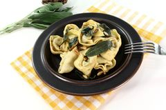 Rocket-ricotta tortellini with fresh sage butter Stock Photo