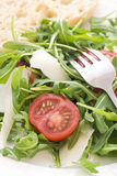 Rocket Salad. With Tomato and Pecorino stock images