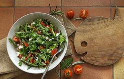 Rocket Salad with arugula leaves and tomato Royalty Free Stock Photo